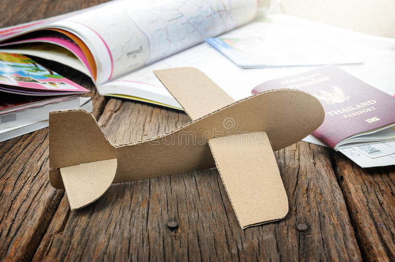 Cardboard plane. On wooden desk with filtered royalty free stock image