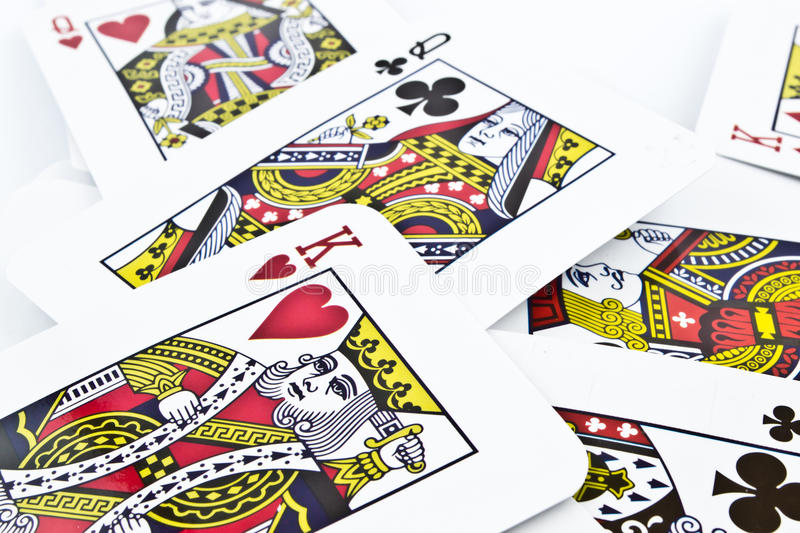 Cardboard playing cards for card games isolated on white background. Cardboard playing cards for card games in studio environment royalty free stock image
