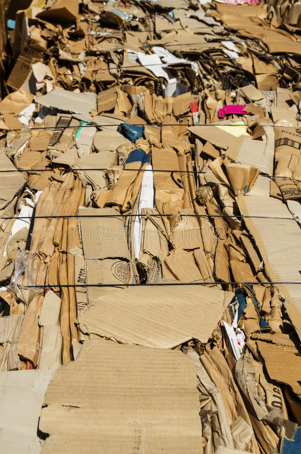 Cardboard Recycling. Old cardboard boxes pressed into bales for recycling stock photos