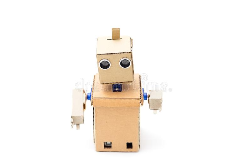 Cardboard robot with hands on a white background. Artificial Int stock photos