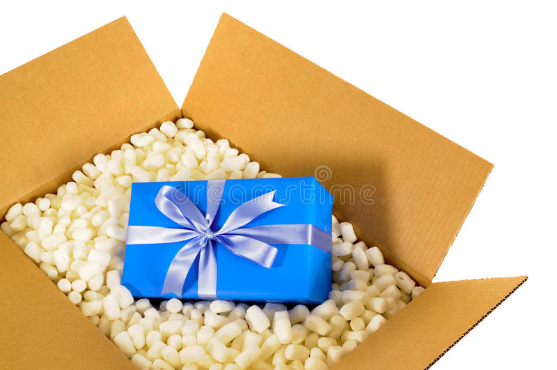 Cardboard shipping delivery box blue gift inside and polystyrene packing pieces stock photography