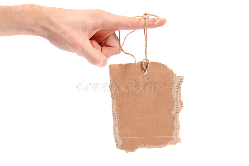 Cardboard tag hanging on finger. Isolated on white background royalty free stock photo