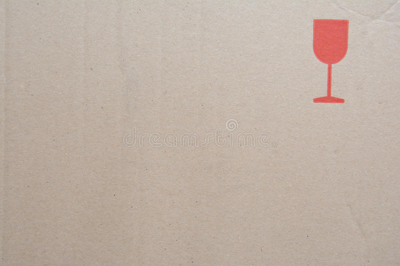 Cardboard texture with fragile symbol stock photography