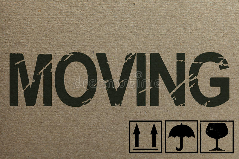 Cardboard texture with moving theme stamps stock photo