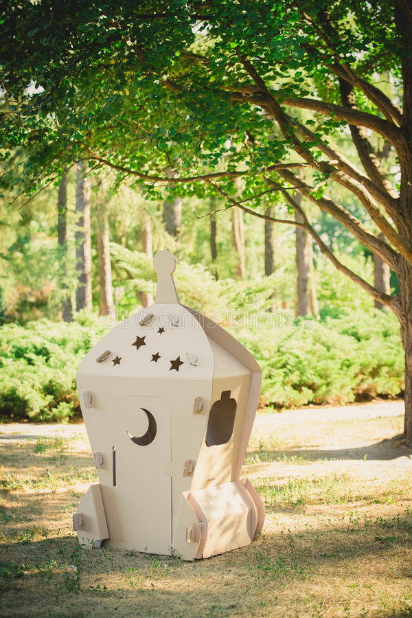 Cardboard toy spaceship in the park. Eco concept royalty free stock image