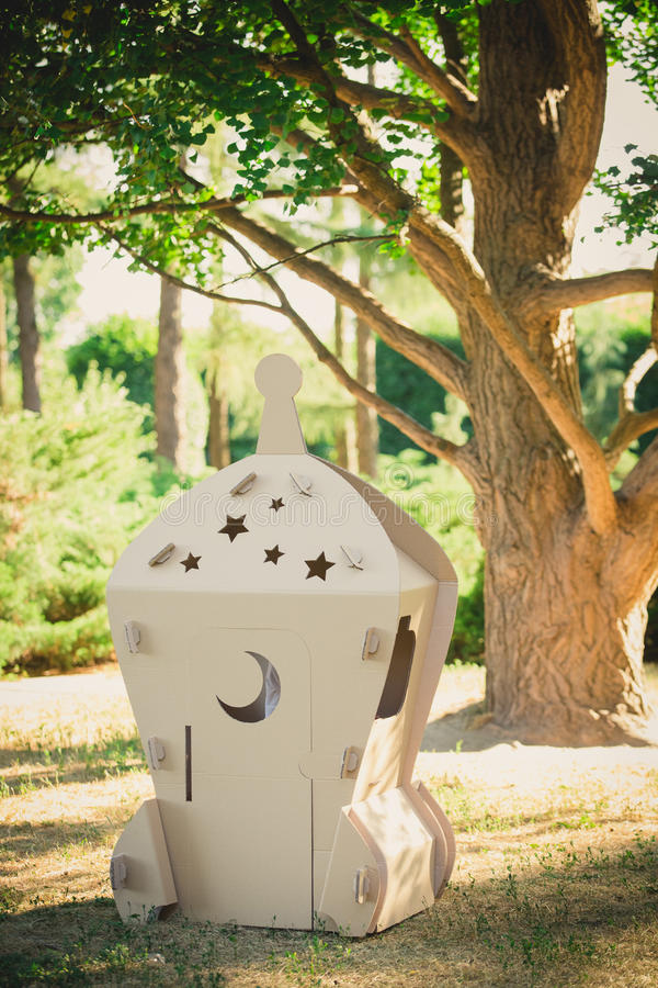 Cardboard toy spaceship in the park. Eco concept royalty free stock photo