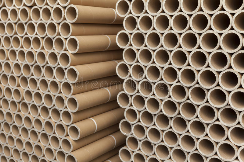 Cardboard tubes on stack stock photos