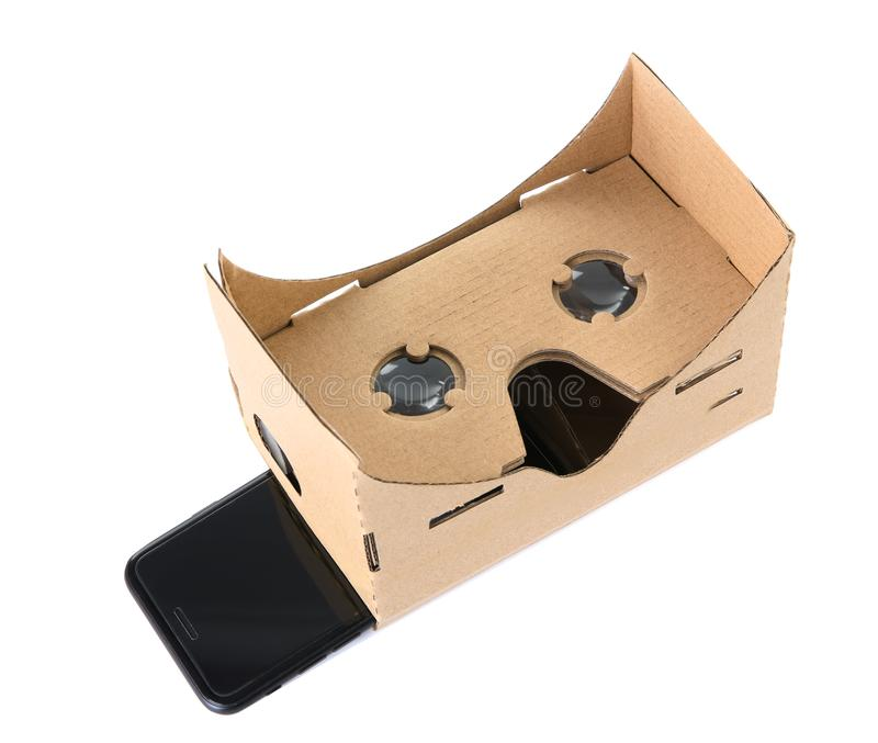Cardboard virtual reality headset and smartphone royalty free stock images