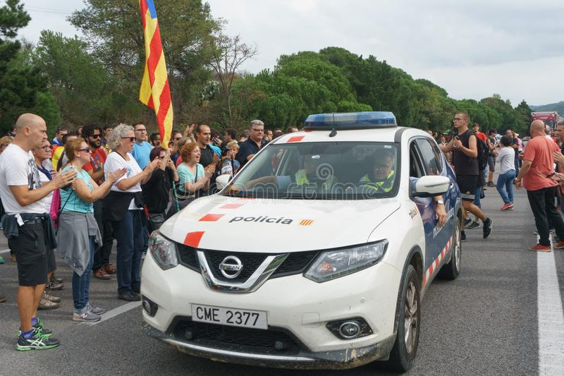 Cardedeu, Catalonia, Spain, October 3, 2017: paceful people cutting. Cardedeu, Catalonia, Spain, October 3, 2017: paceful people applauding mossos d`esquadra stock image