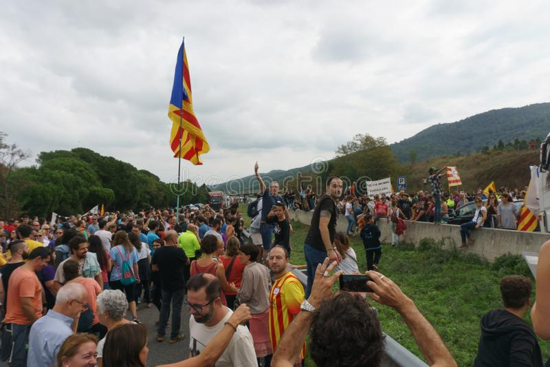 Cardedeu, Catalonia, Spain, October 3, 2017: paceful people cutting. Off the highway AP-7 in protest for spanish police repression of first october royalty free stock photo
