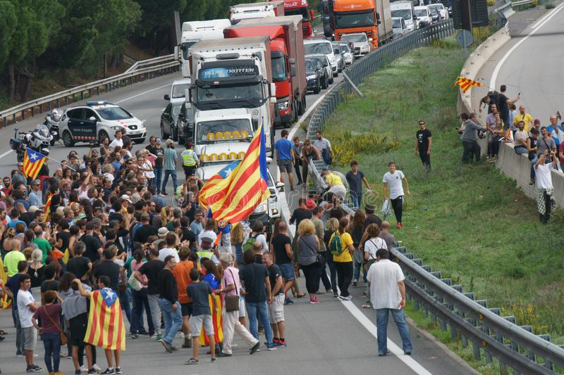Cardedeu, Catalonia, Spain, October 3, 2017: paceful people cutting off the highway. AP-7 in protest for spanish police repression of first october royalty free stock photography