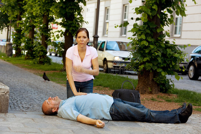 Cardiac massage. First aid for heart attack stock photography
