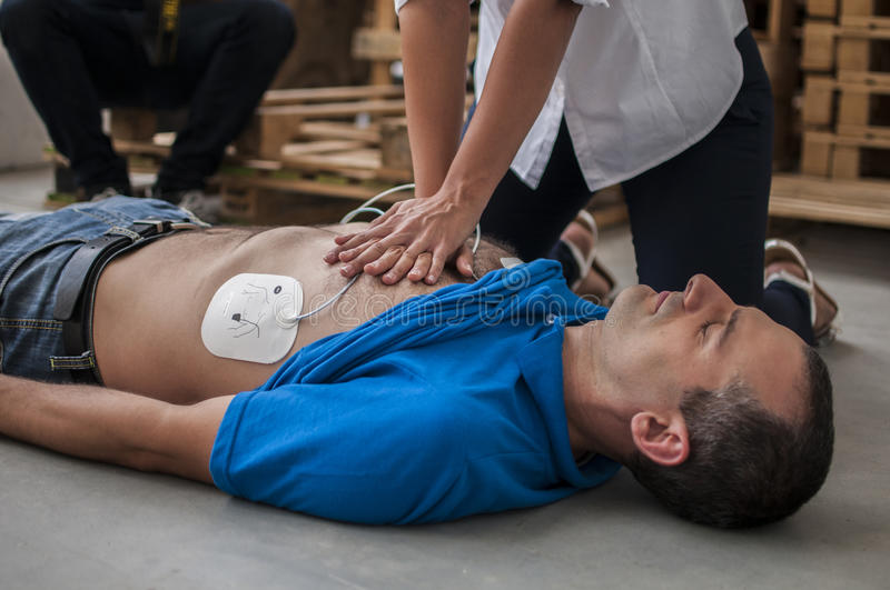 Cardiac massage. Rescuer making cardiac massage after heart attack and defibrillation stock photography