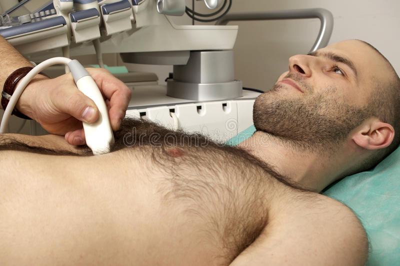 Cardiac ultrasound examination. Testing on young men royalty free stock photography