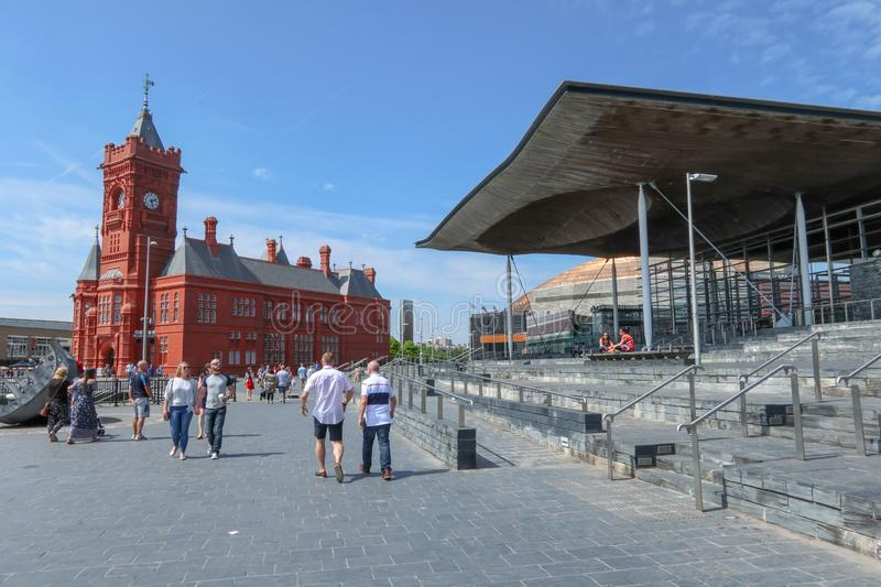 Cardiff Bay landmarks and tourists sunny day stock photos