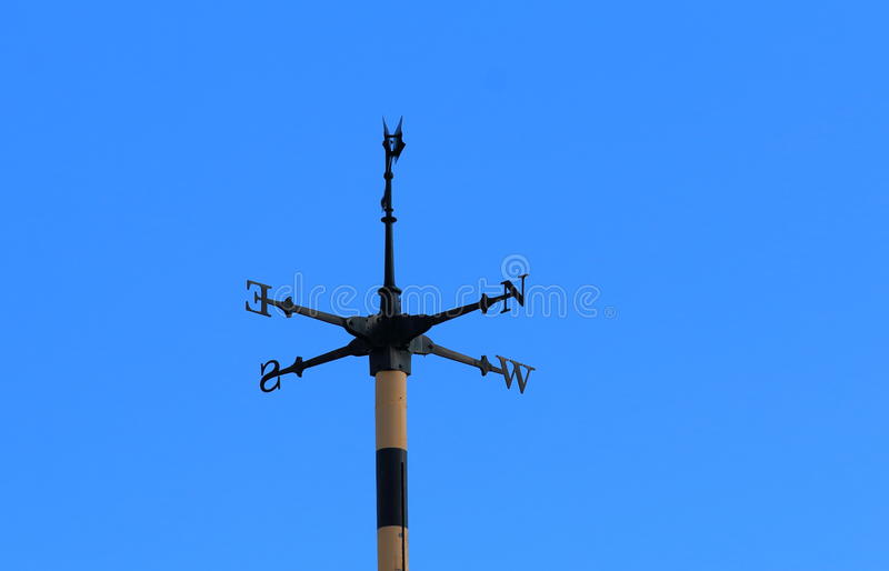 Cardinal direction points blue sky stock photo