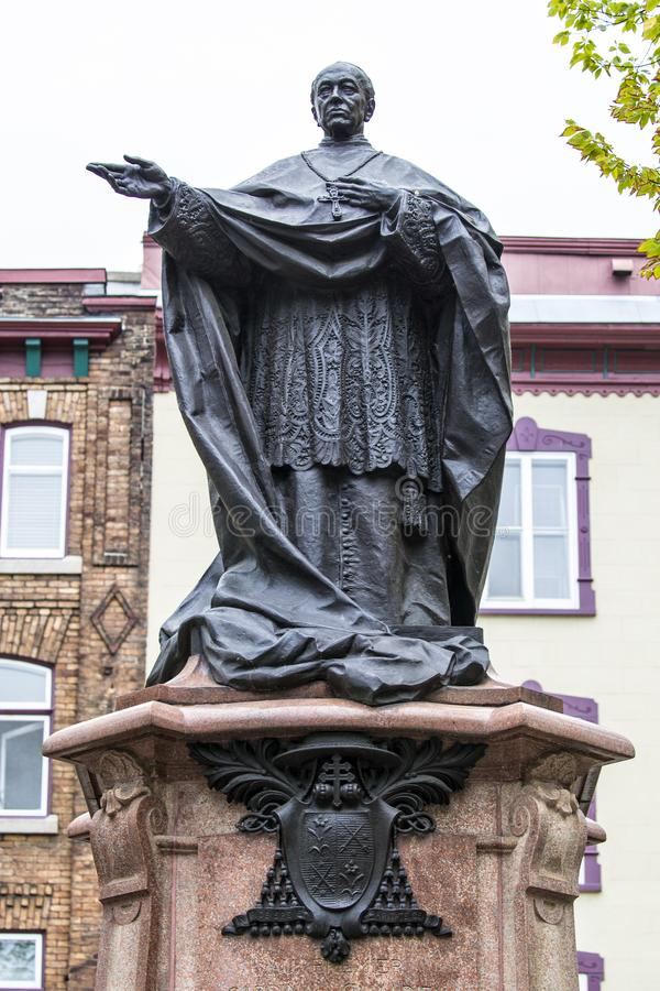 Cardinal statue in Quebec City Canada. Cardinal statue giving blessing  in Quebec City Canada royalty free stock photography