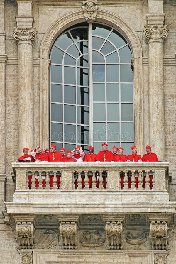Cardinals on balcony of Saint Peter's Basilica. VATICAN - APRIL 19: Cardinals wearing red suits on the balcony of Saint Peter's Basilica after election of new stock photography