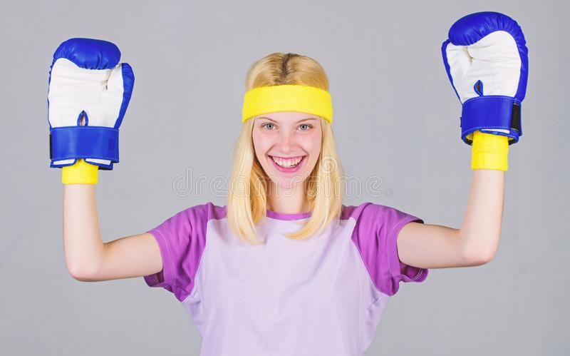 Cardio boxing exercises to lose weight. Femininity and strength balance. Woman boxing gloves enjoy workout. Girl learn. How defend herself. Woman exercising royalty free stock image