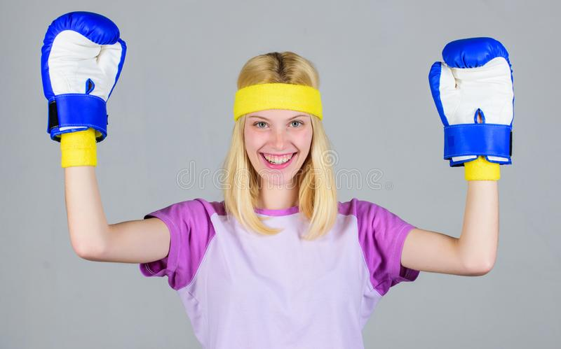Cardio boxing exercises to lose weight. Femininity and strength balance. Woman boxing gloves enjoy workout. Girl learn. How defend herself. Woman exercising stock photos