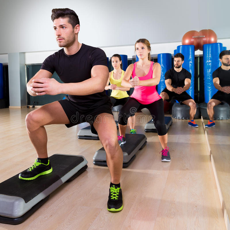 Workout Photography: Cardio Step Dance Squat Group At Fitness Gym Stock Photo