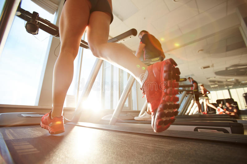 Cardio workout on treadmill stock photography