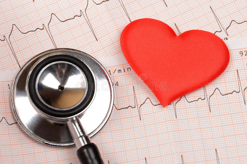 Cardiogram chart with heart and stethoscope stock photography