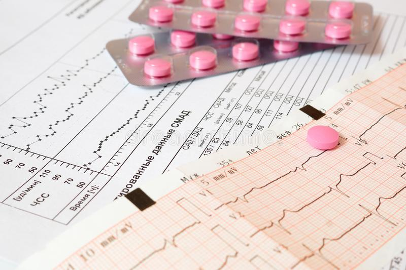 Cardiogram and medication. stock photo