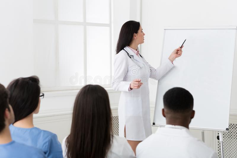 Cardiologist sharing experience with colleagues at seminar royalty free stock photos