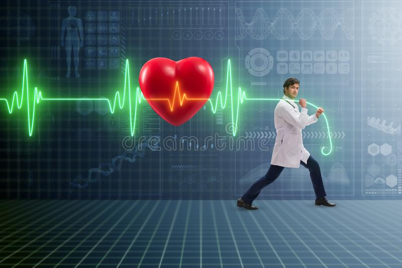 The cardiologist in telemedicine concept with heart beat stock images