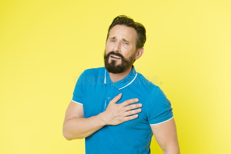 Cardiology disease. Man mature sportsman painful face feel badly heart rate problem. Problems health appears with ageing royalty free stock images