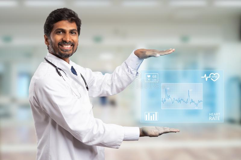 Cardiologyst presenting heart monitoring screen stock photos