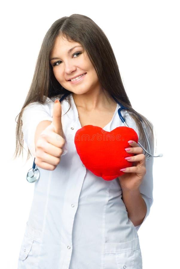Cardioloog met een hart gevormd hoofdkussen stock afbeeldingen