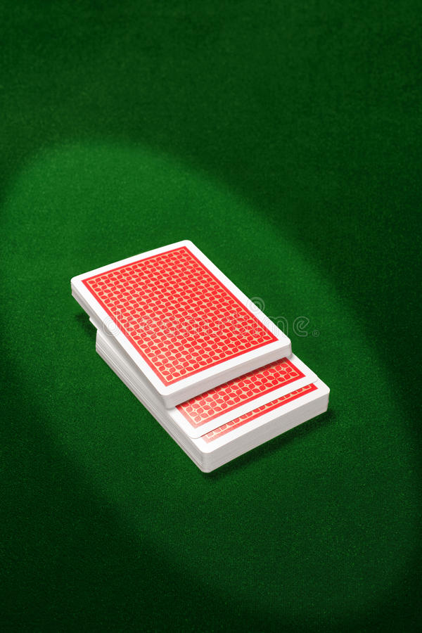 Cards. Plaing cards on green background royalty free stock photos