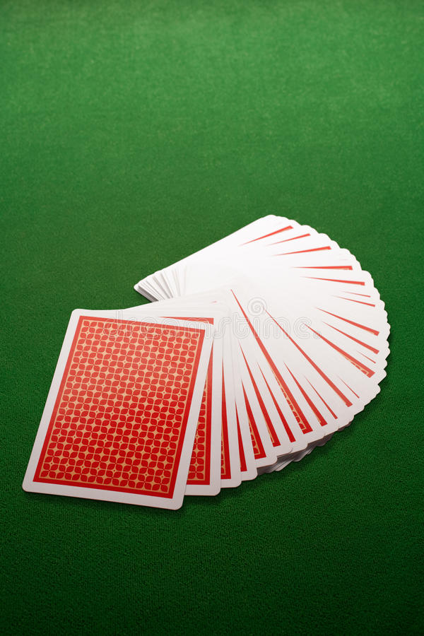 Cards. Plaing cards on green background royalty free stock images