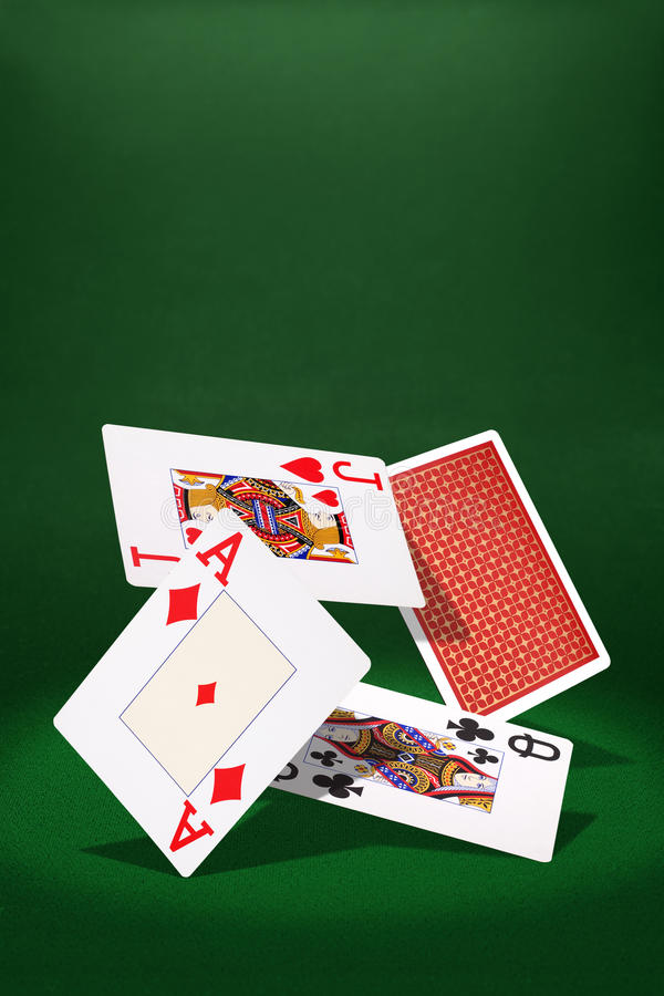 Cards. Plaing cards on green background stock images
