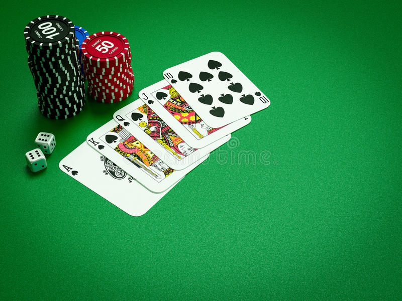 Cards and chips for poker on green table. High resolution stock image