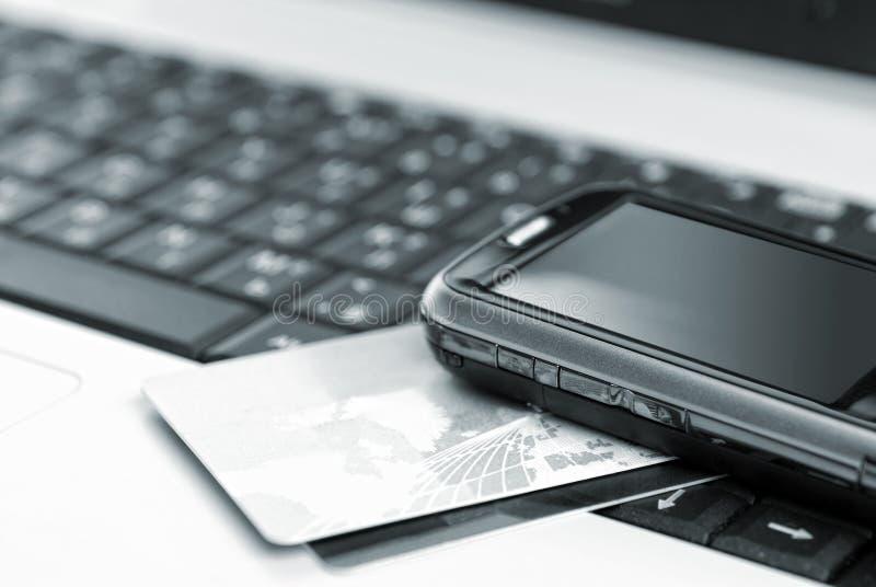 cards den mobila anteckningsboktelefonen arkivfoto