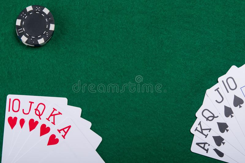 Cards on a green poker table from two poker players stock photos