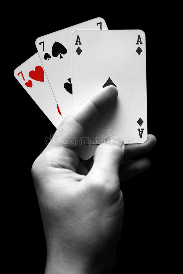 Cards in hand stock photo