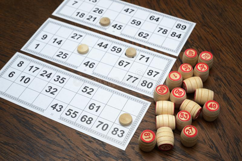 Cards and kegs for lotto game on the table. Cards and kegs for lotto game on the wooden table stock photo