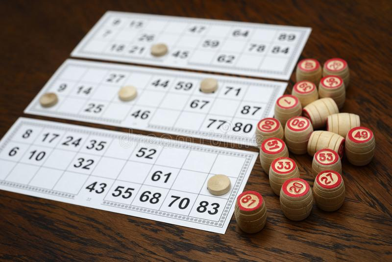 Cards and kegs for lotto game on the table. Cards and kegs for lotto game on the wooden table stock photography