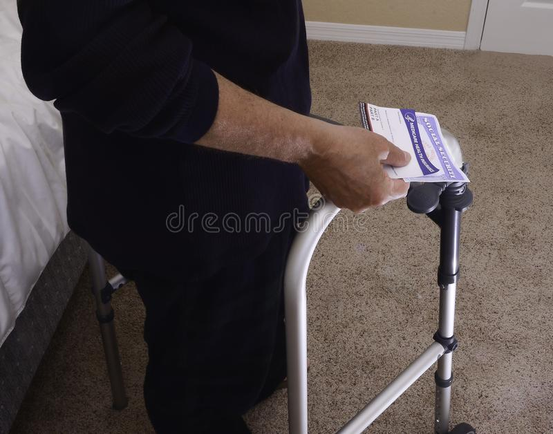 Handicap man with cards used in retirement for financial security and to provide healthcare royalty free stock photography