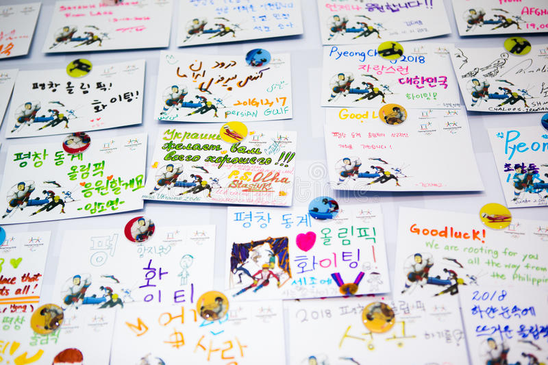 Cards on the wall made by tourists with regards to the guests and the organizers of the Olympic Winter Games 2018 royalty free stock image