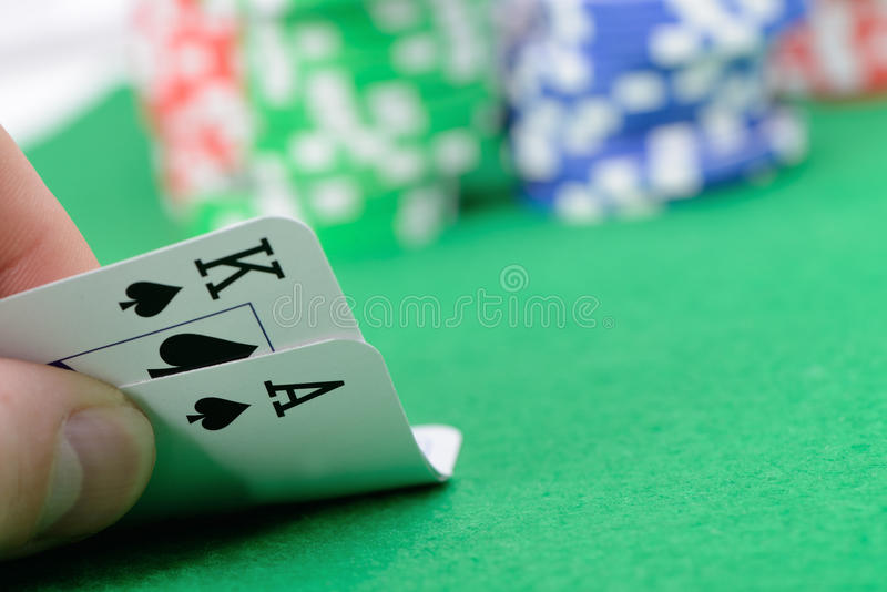 Cards winning combination in Black Jack in hand. Gaming cards in hand on the green cloth. A winning combination in Black Jack stock photo