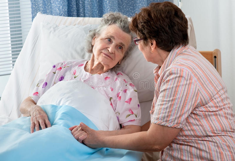Care. Senior female is being visited by the daughter in hospital