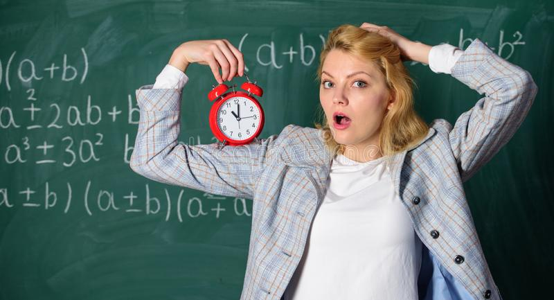 She care about discipline. Woman teacher hold alarm clock. Lessons schedule concept. Time for break. Time has matter for. Her. Welcome teacher school year stock photo