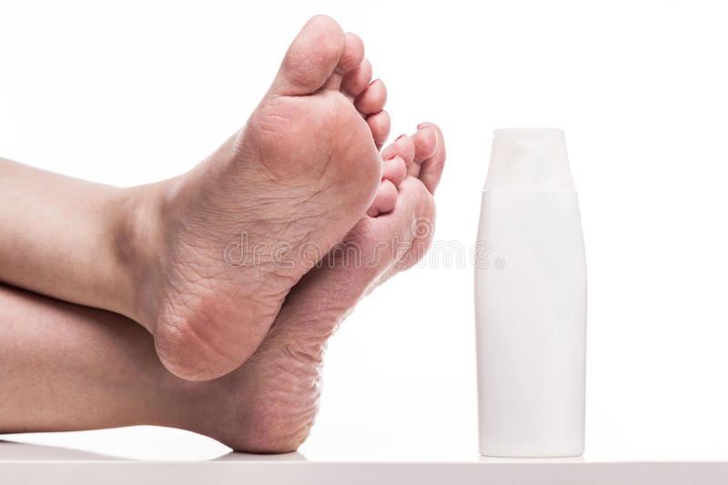 Care for dry skin on the well-groomed feet and heels with creams. For the skin and feet royalty free stock images