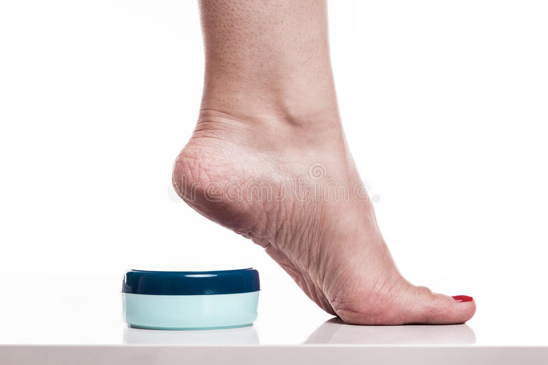 Care for dry skin on the well-groomed feet and heels with creams. For the skin and feet stock image