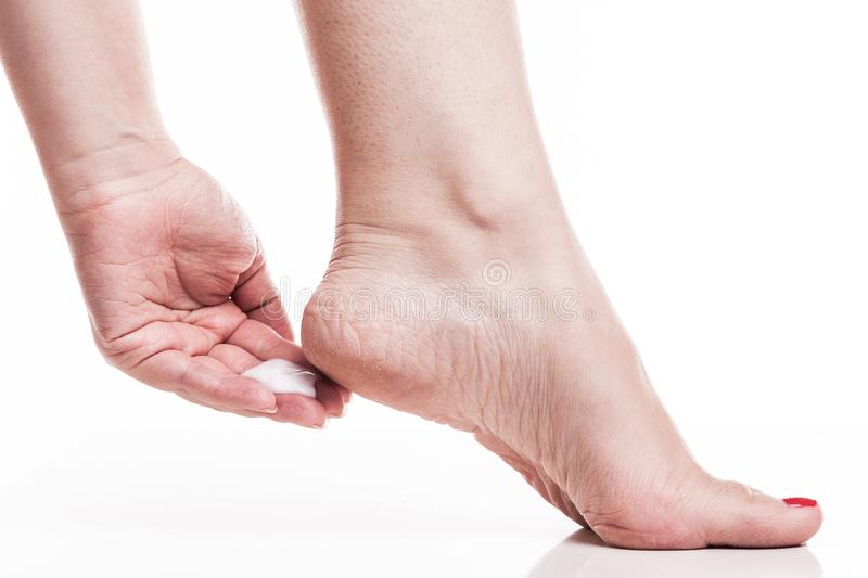 Care for dry skin on the well-groomed feet and heels with creams. For the skin and feet stock photos